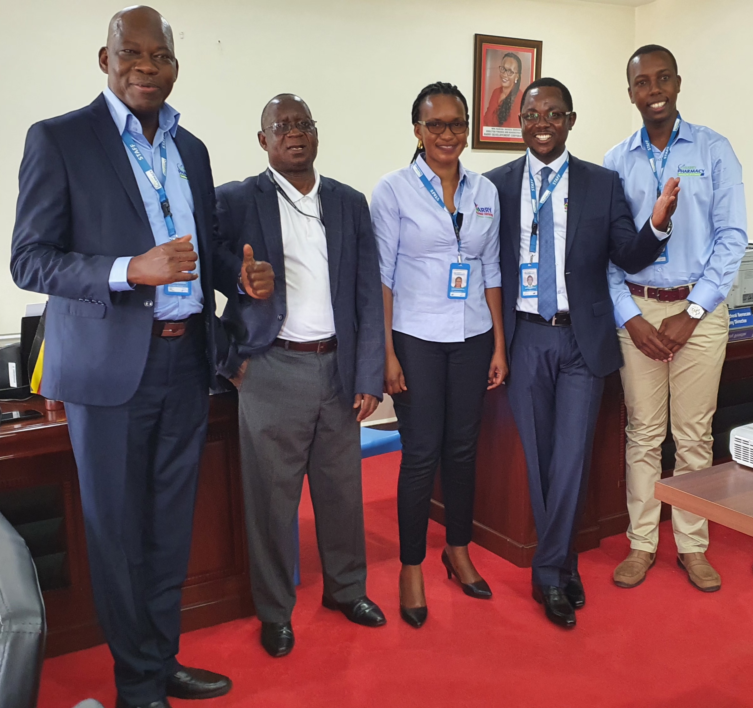 Board of Directors of Barry Development Corporation share a light moment at the Company Headquarter 
