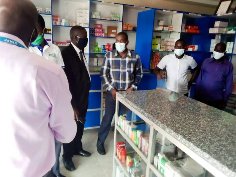 Management of Barry Medical Centre chatting with a team from Ministry of Health at the Pharmacy